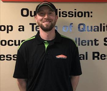 Male SERVPRO Employee Standing in front of a wall